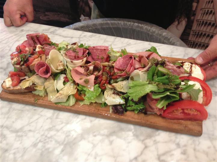 anti-pasta board with meats, lettuce and tomatoes