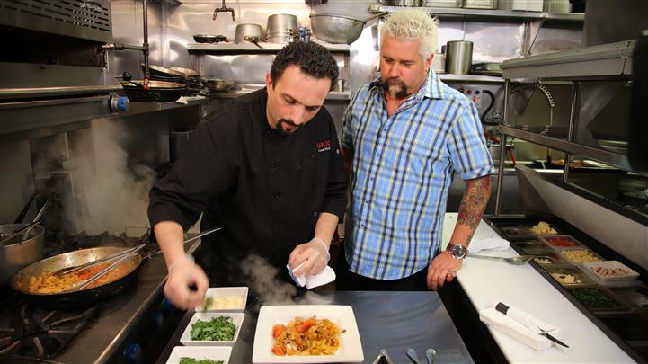 guy fieri and chef in the kitchen preparing food