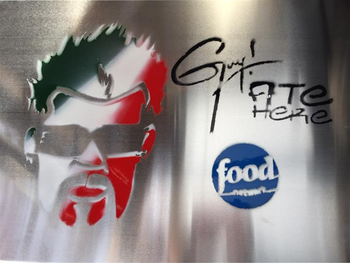 metal signage of guy fieri and the food network