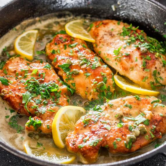 marinated chicken fillets in a skillet