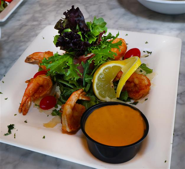 salad with shrimp, lemon, and a dipping sauce