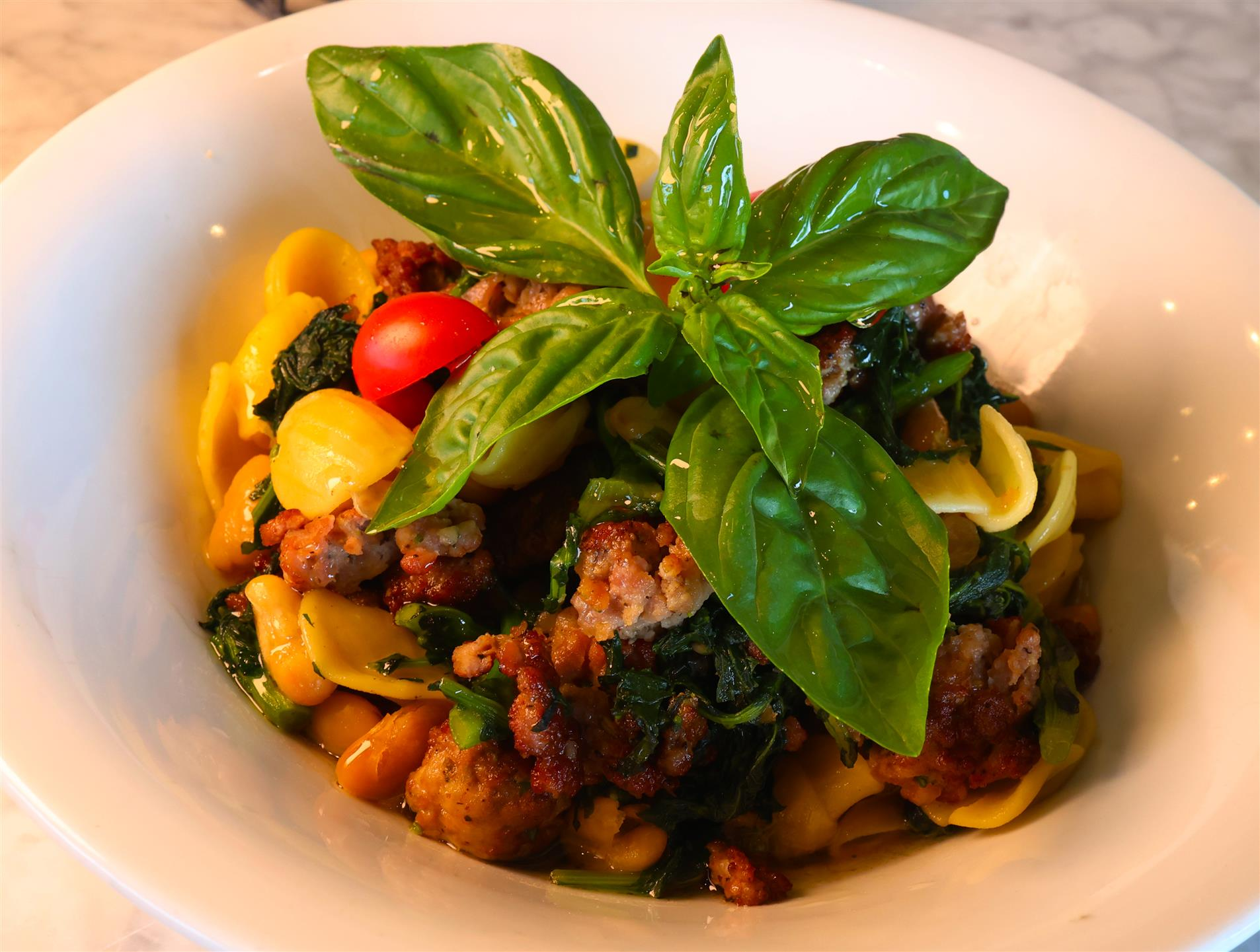 pasta with sausage, tomatoes, and spinach