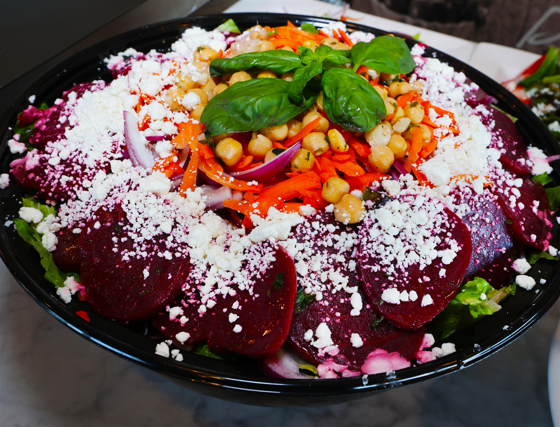 Beet Salad with Crispy heart of Romaine & Iceberg Lettuce Surrounded by Marinated Sliced Beets, Red Onions, Carrots, Goat Cheese & Chick Peas Drizzled with Balsamic Glaze