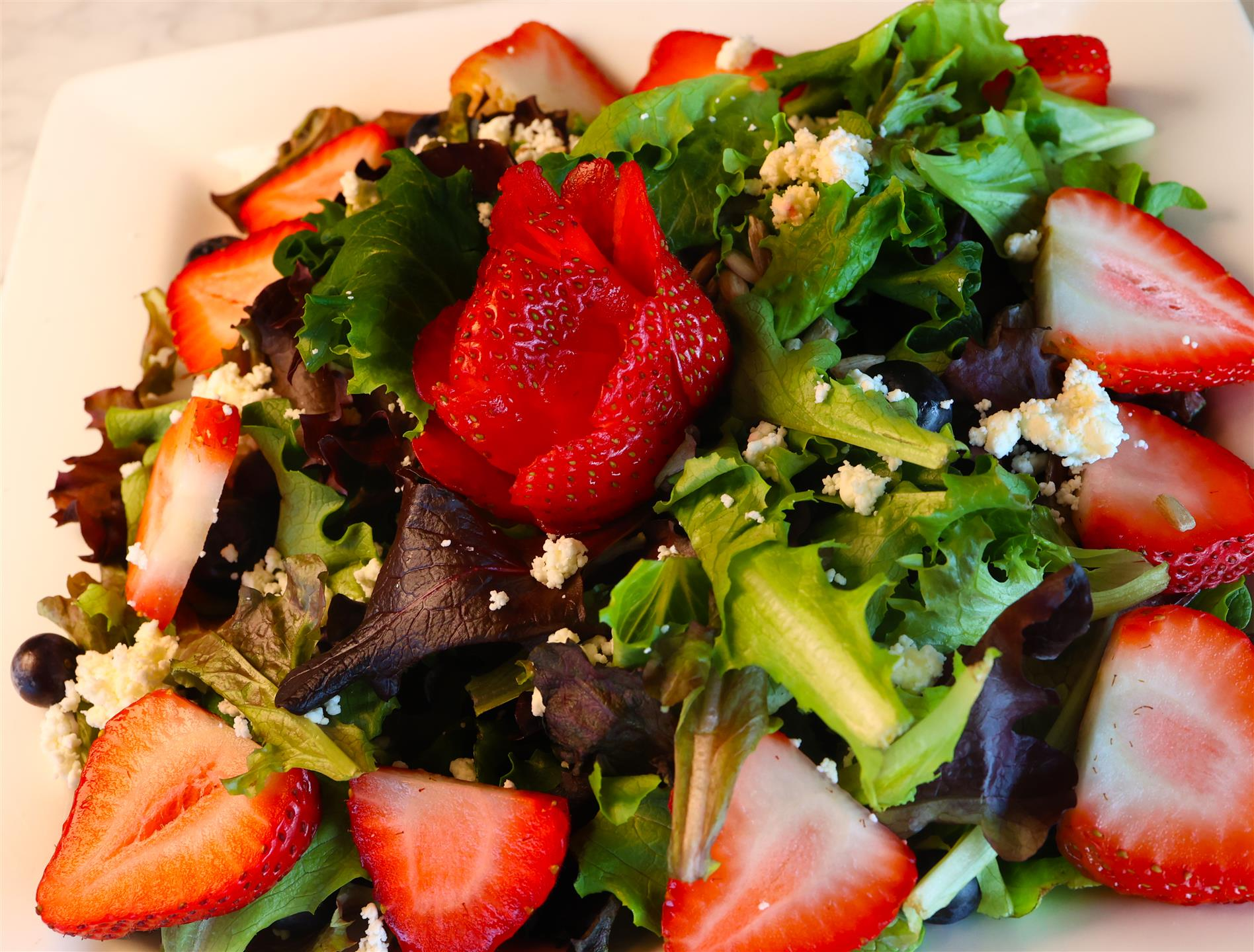 Berry Crunch salad with Mixed greens, strawberry, goat cheese, sunflower Seeds, served with Raspberry vinaigrette