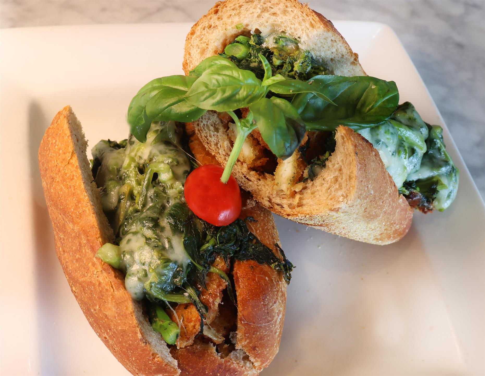 Chicken Pomodoro sandwich with Grilled Chicken, Fresh Baby Spinach, Provolone Cheese, Tomatoes and Roasted Garlic Mayo