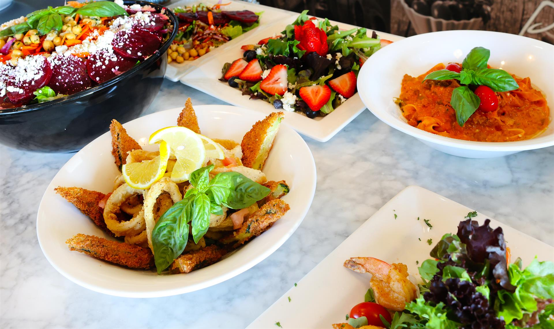 a variety of different dishes on a table from carluccio's