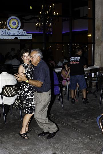 Man and woman dancing cheek to cheek