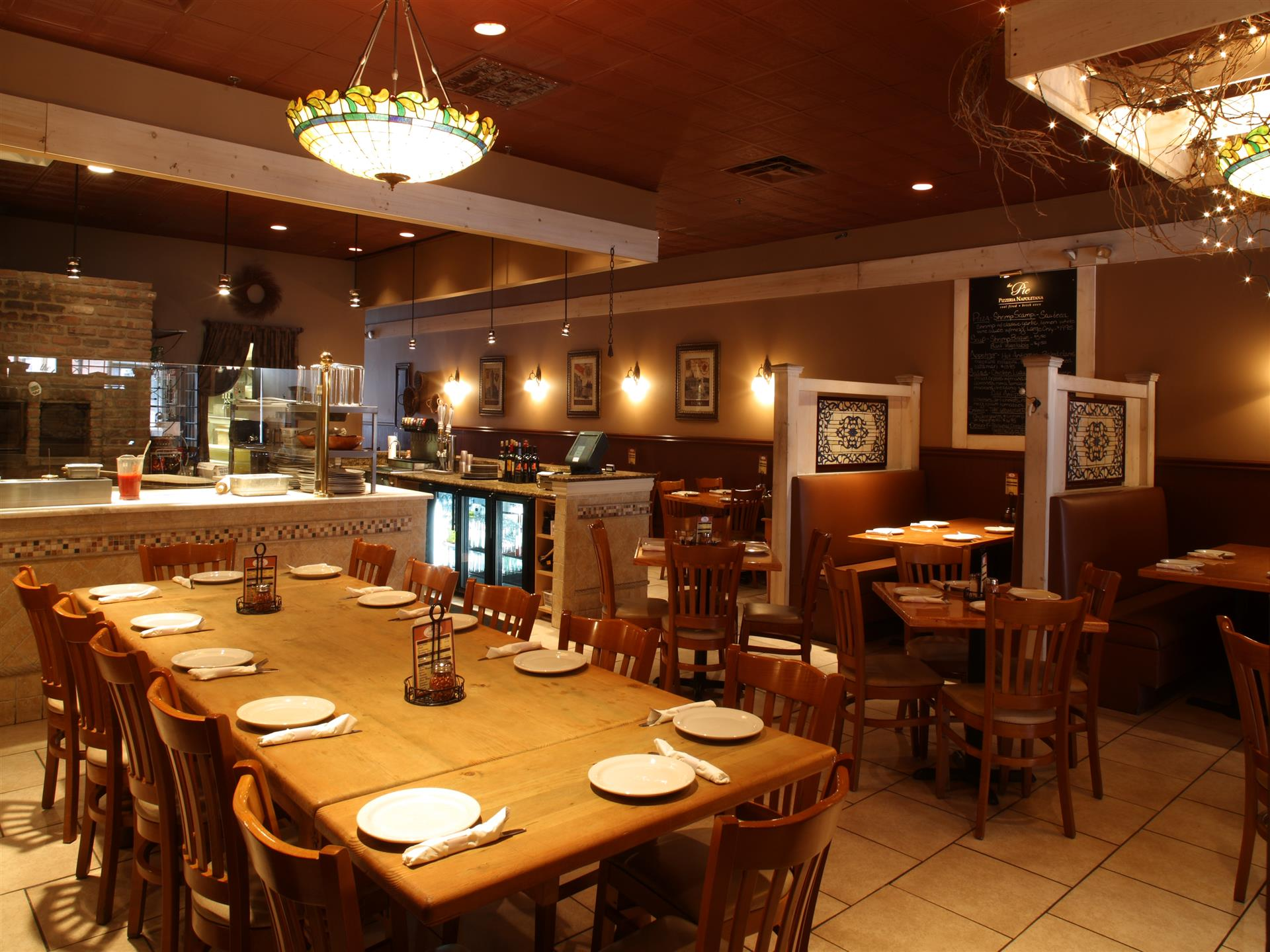 interior of restaurant with tables and booths set for service