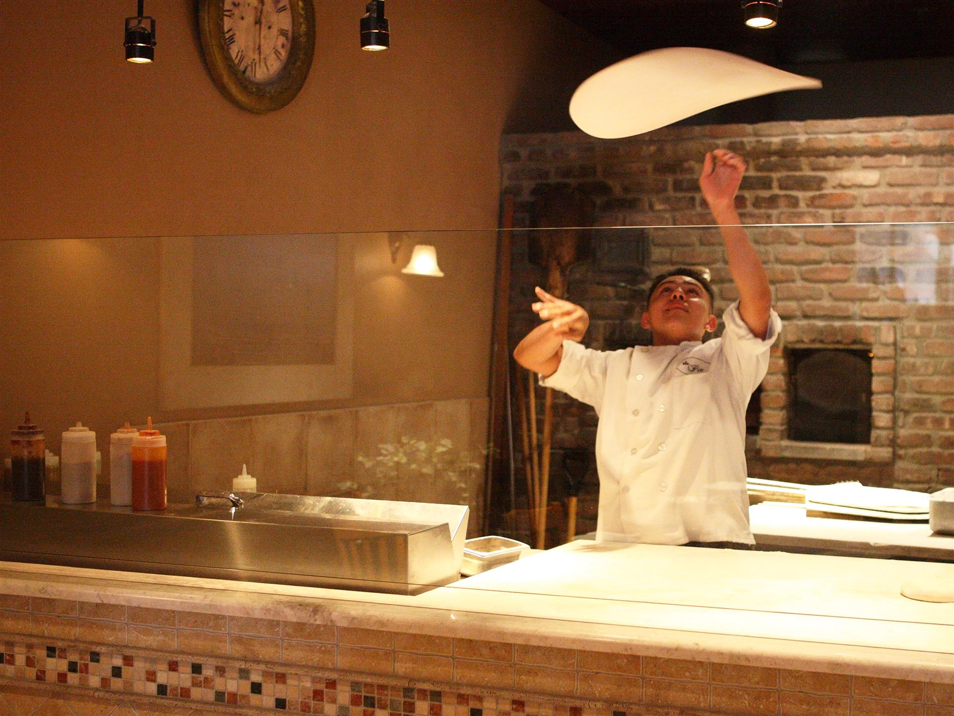 pizza man throwing dough in air