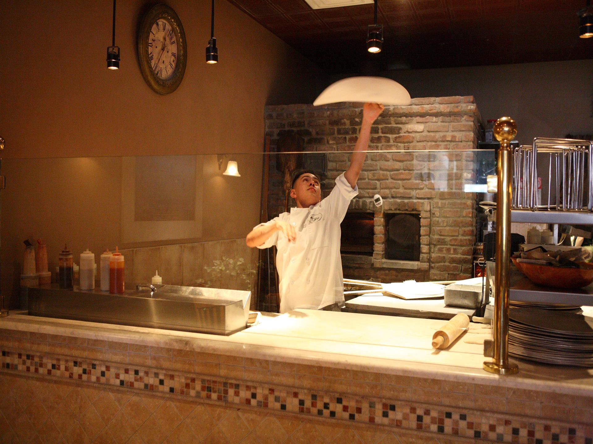 pizza man throwing dough