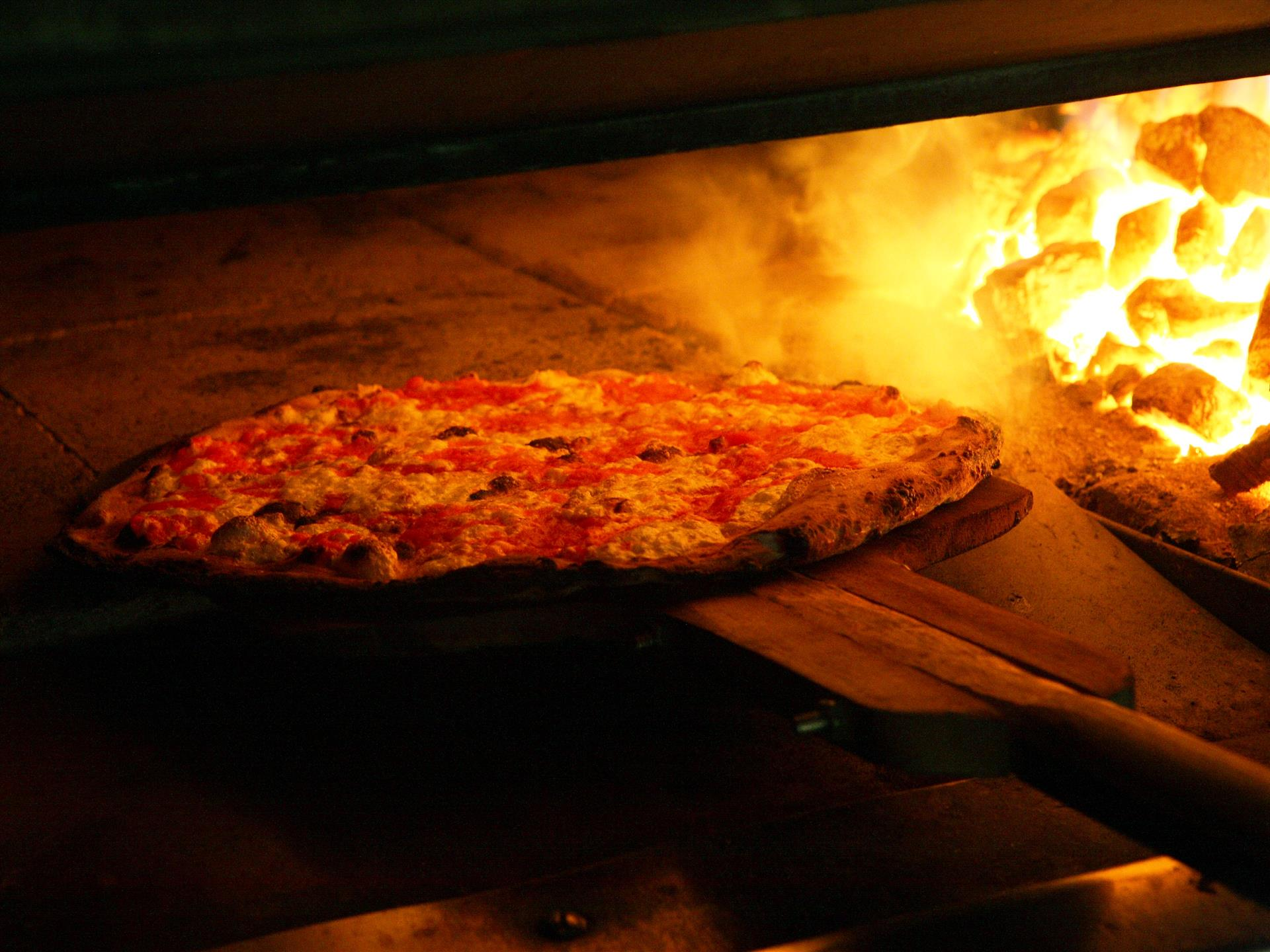 pizza inside brick oven