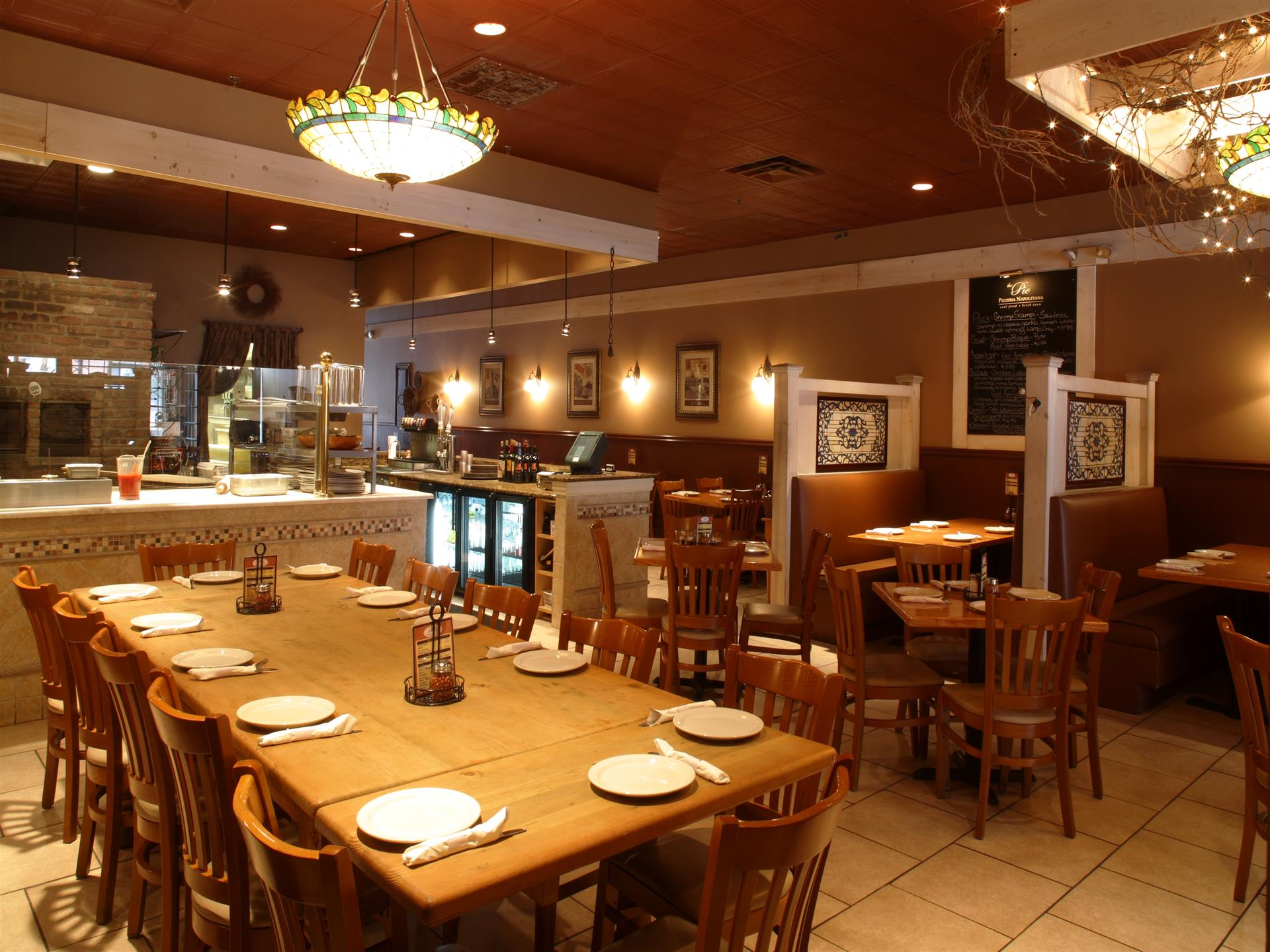interior of restaurant set with tables and booths for service