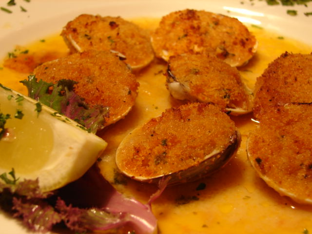 Baked clams casino with a lemon wedge