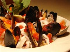 Seafood pasta with mussles and calamari in red sauce