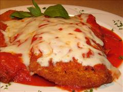 Chicken parmesan with tomato sauce