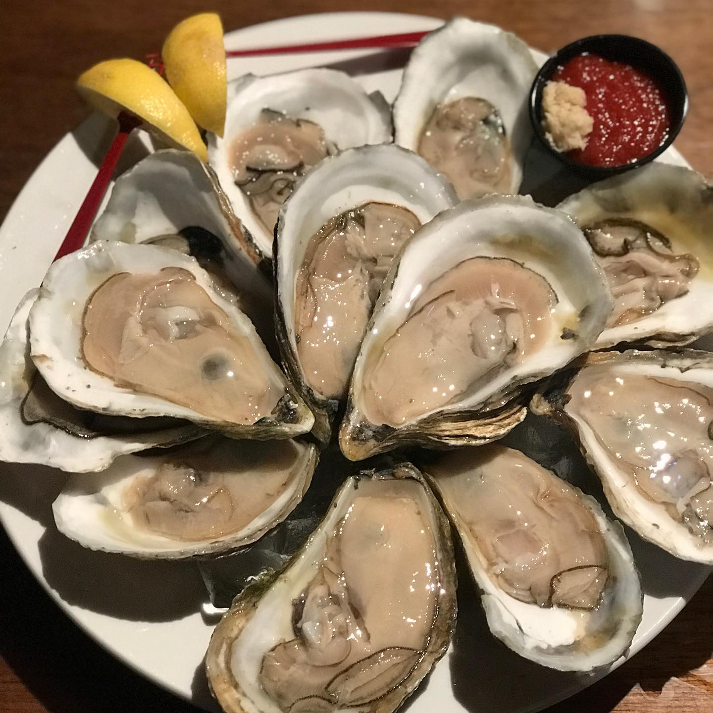 plate of oysters with sauce