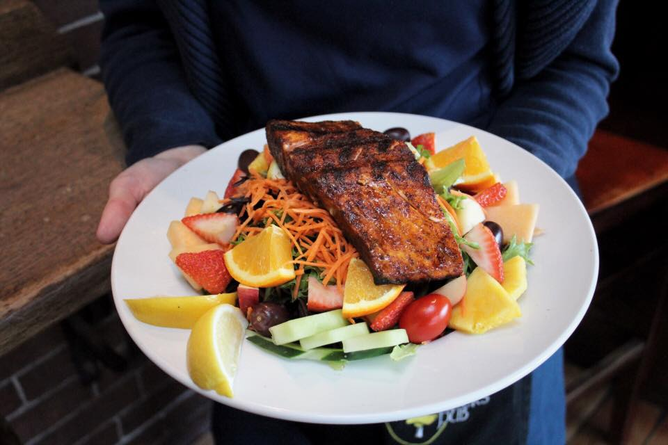 grilled salmon over fruit