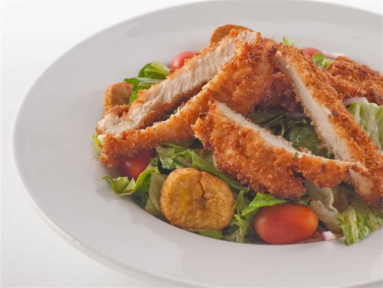 fried chicken fingers over a salad