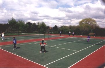 two tennis courts with young people playing games