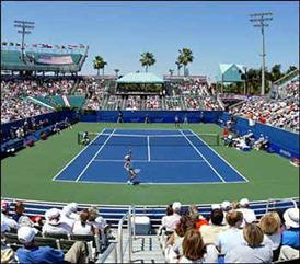 tennis court stadium with a full crowd during the day time