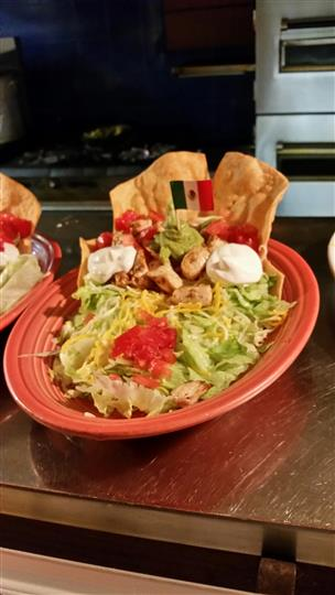 Taco salad with chicken, sour cream, guacamole