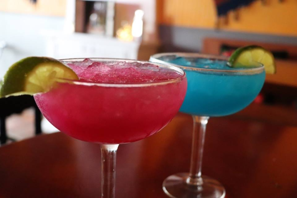 Two colorful margaritas on table