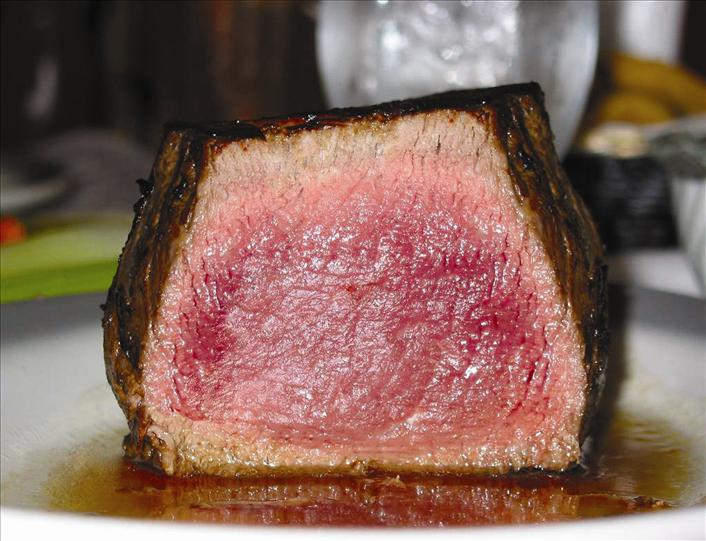 Medium rare filet mignon cut open in the center.