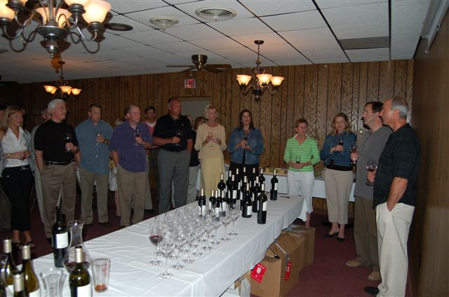 Archie's Friends and Family enjoying a wine tasting event.