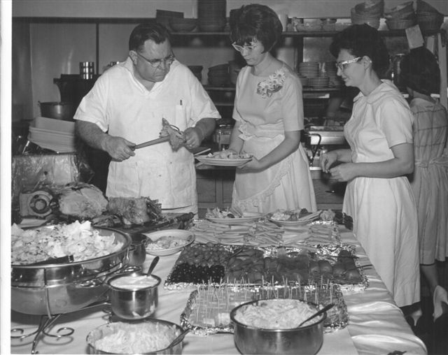 Vintage photo of Archie and restaurant staff preparing a large event