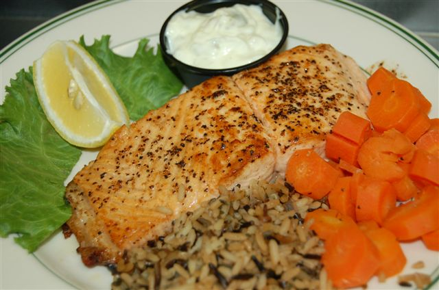 Grilled salmon plate with rice, and carrots.