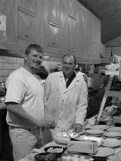 Two chefs cooking in the Archie's Waeside kitchen