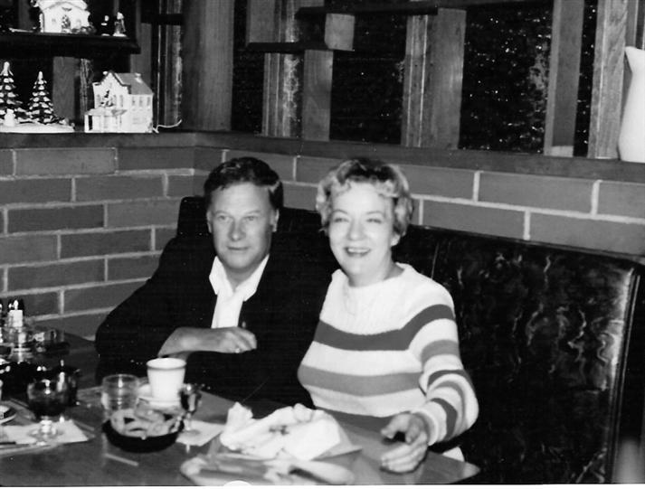 Vintage photo of a couple sitting at a booth at Archie's Waeside smiling and eating dinner.