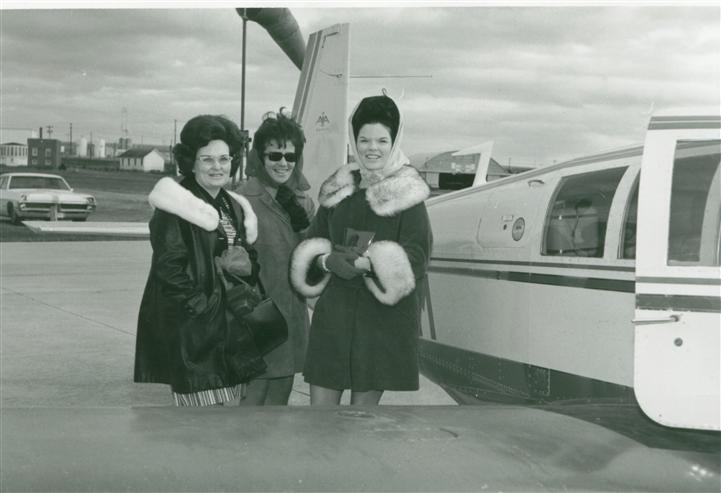 Vintage photo of three women boarding a private plane