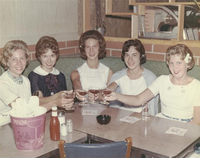 Vintage photo of five women toasting in a booth at archie's waeside