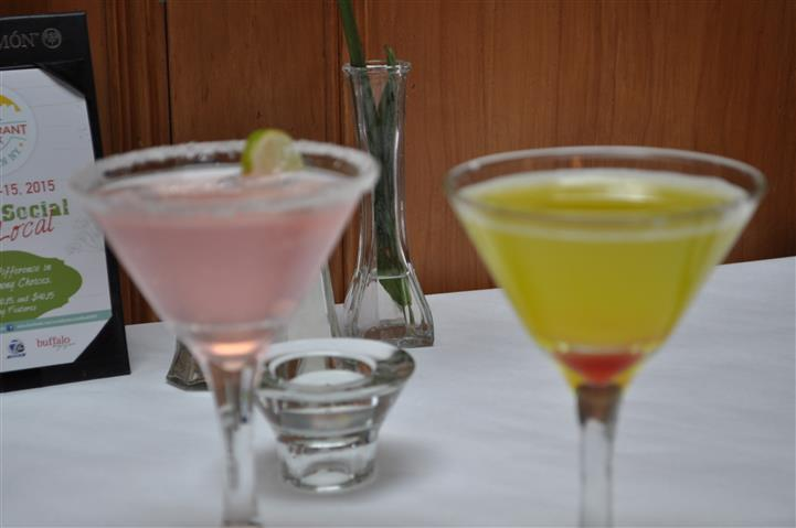 pink and yellow drink in martini glasses