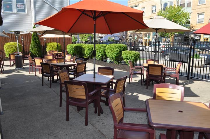 tables outside with orange umbrella