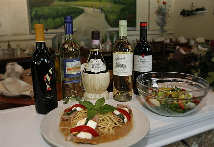 selection of wine next to an entree