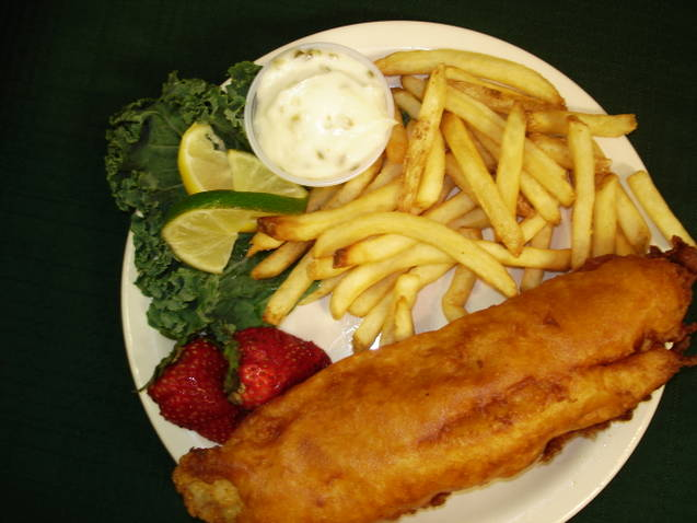 Fried fish with French fries and strawberries