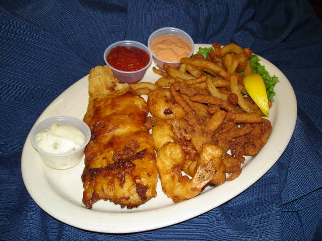 Fried shrimp with French fries and sipping sauce