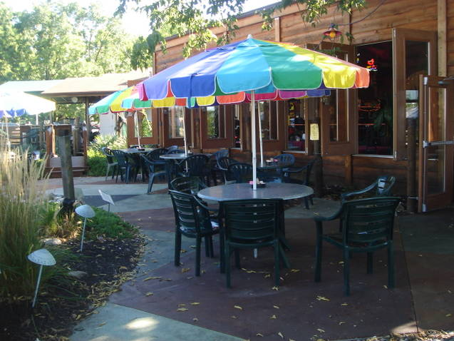 Outdoor patio with dining tables with umbrellas