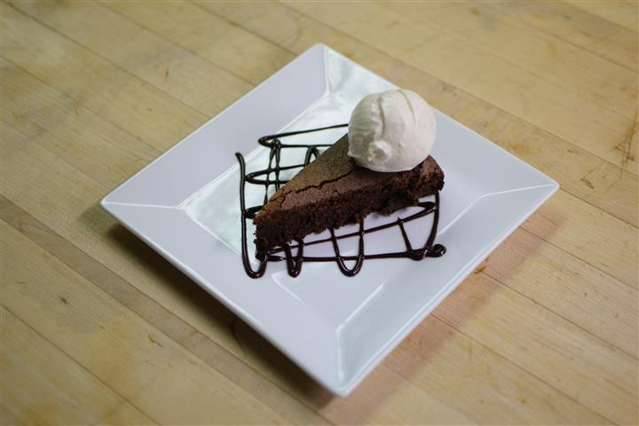 Chocolate cake with ice cream scoop