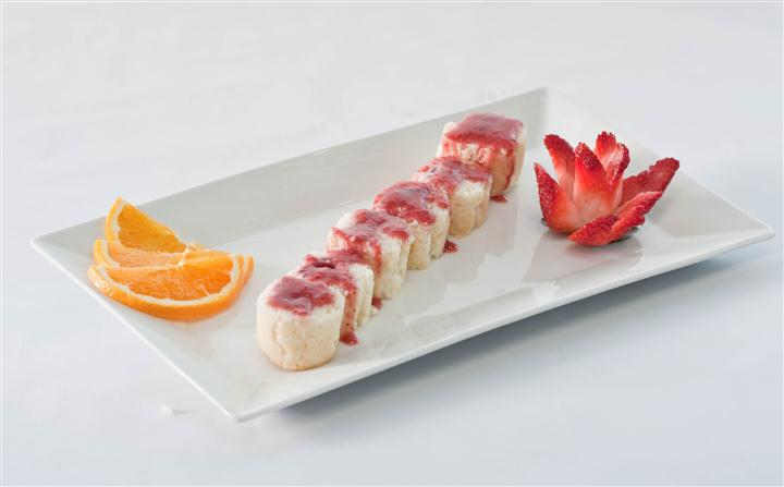 Sushi Platter containing 6 rolls complimented with 2 orange slices and a elegantly cut strawberry