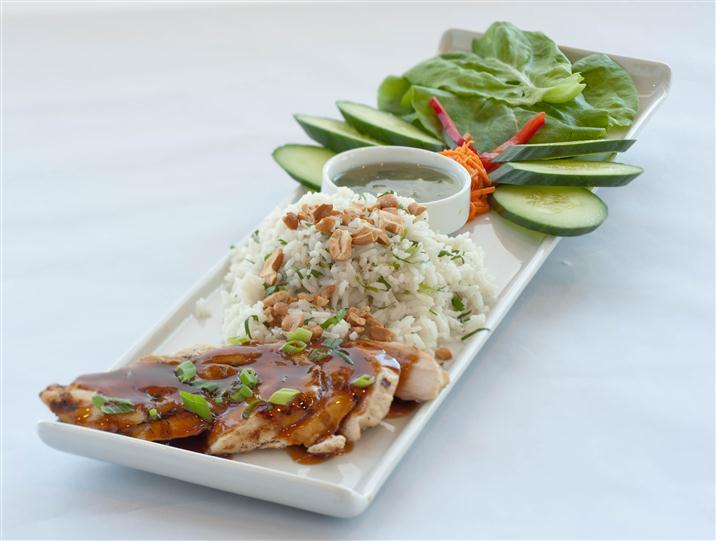 Chicken teriyaki served along with rice and sliced vegetables