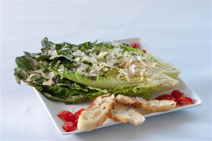 Lettuce served with bread and tomatoes