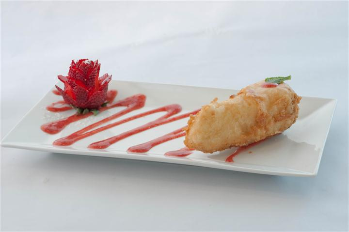 Tempura served with an elegantly cut strawberry and aesthetically displayed sauce