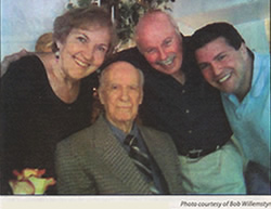 4 people smiling at the camera
