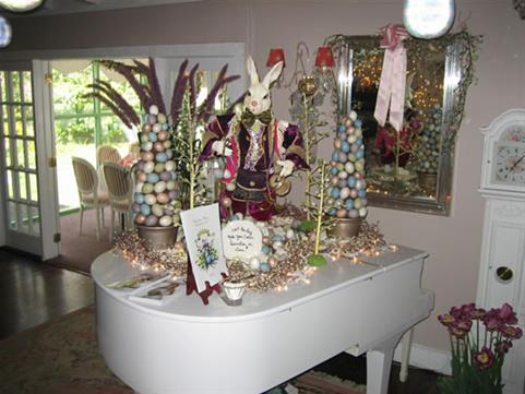 piano with christmas decorations on top