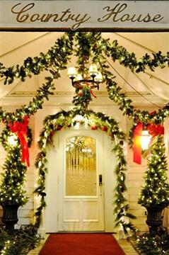 front door to restaurant with christmas decorations