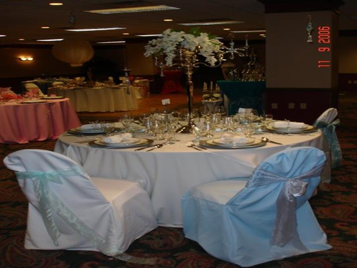 Set table with flower decoration and dining ware