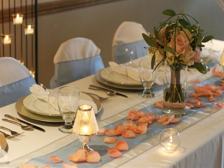 Set table with rose petals